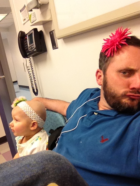 Phoebe and daddy wait in the clinic to be admitted